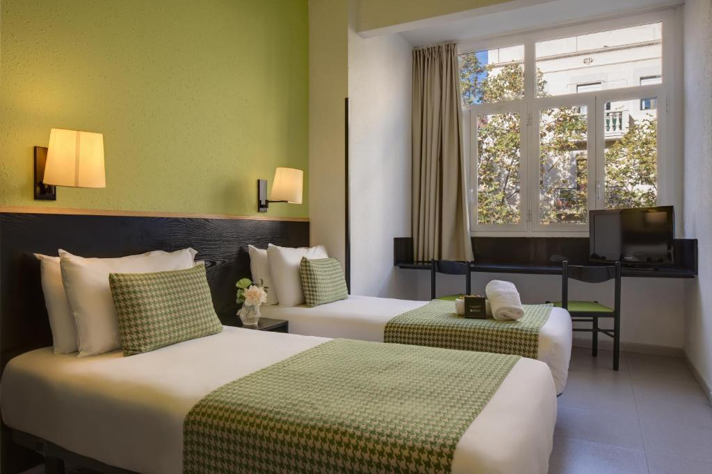 A bed or beds in a room at H·TOP BCN City