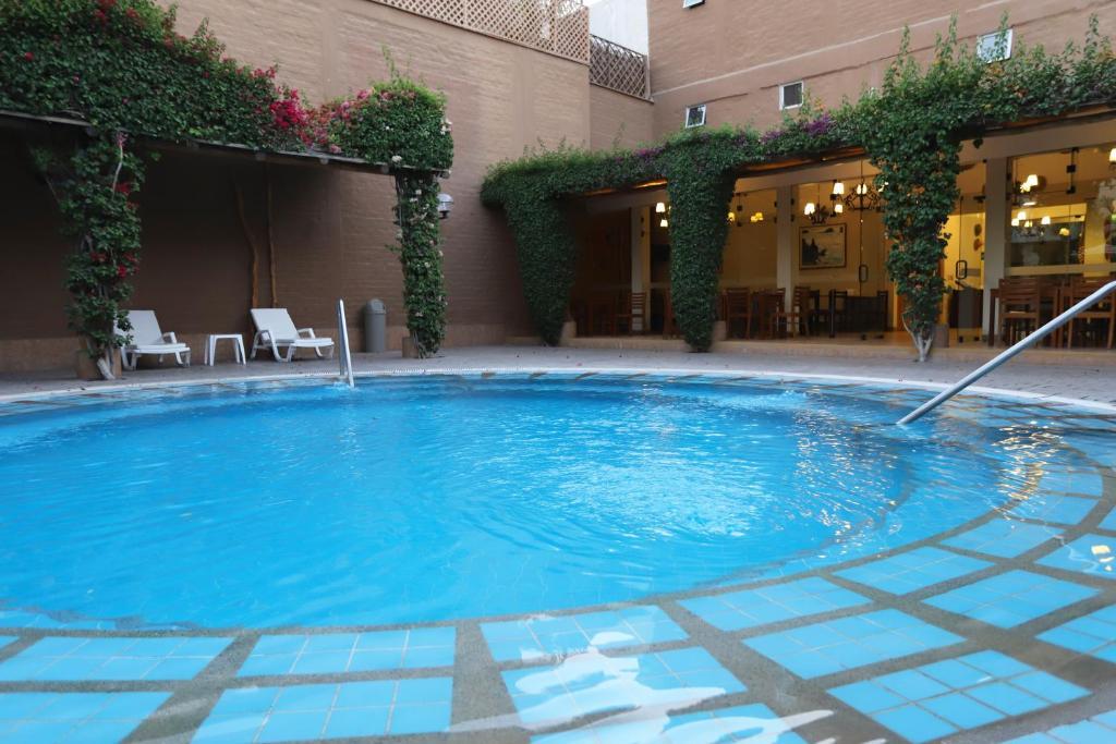 The swimming pool at or near Casa Andina Standard Nasca
