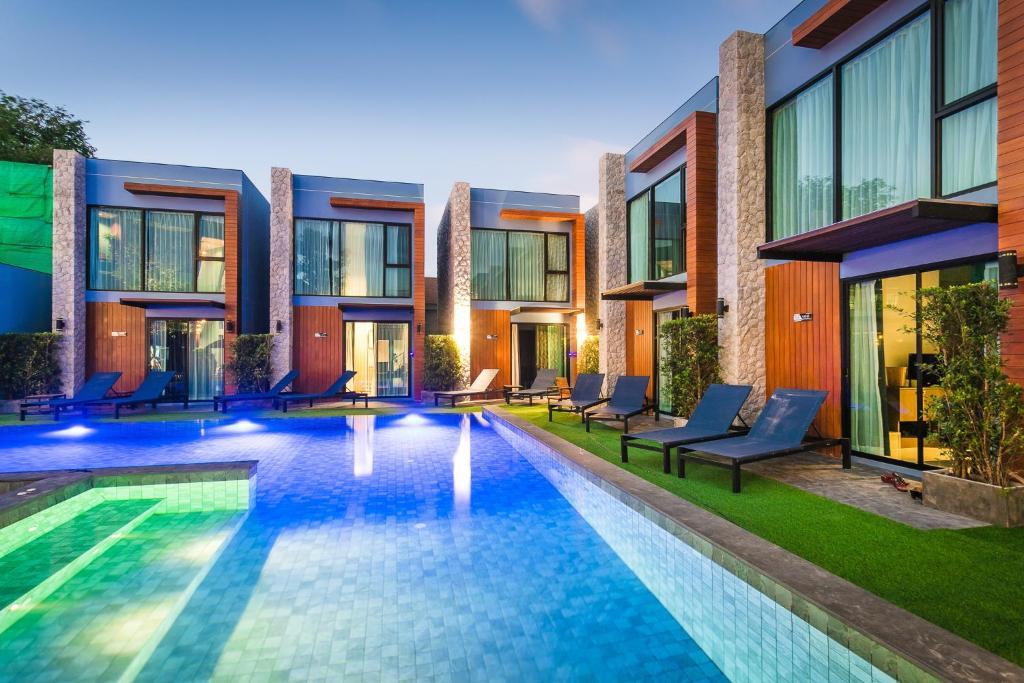 The swimming pool at or near Peace Blue Naiharn Naturist Resort Phuket