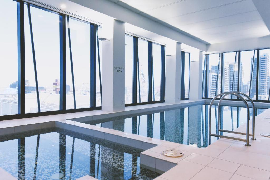 The swimming pool at or near HFN Southern Cross Apartment
