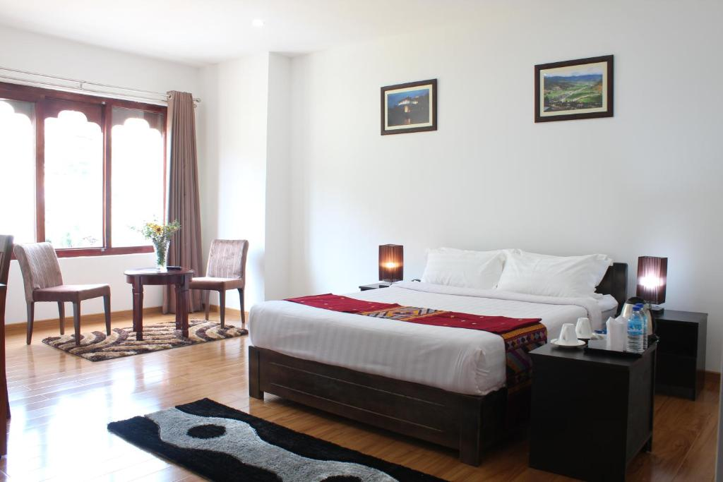 A bed or beds in a room at Hotel Riverside