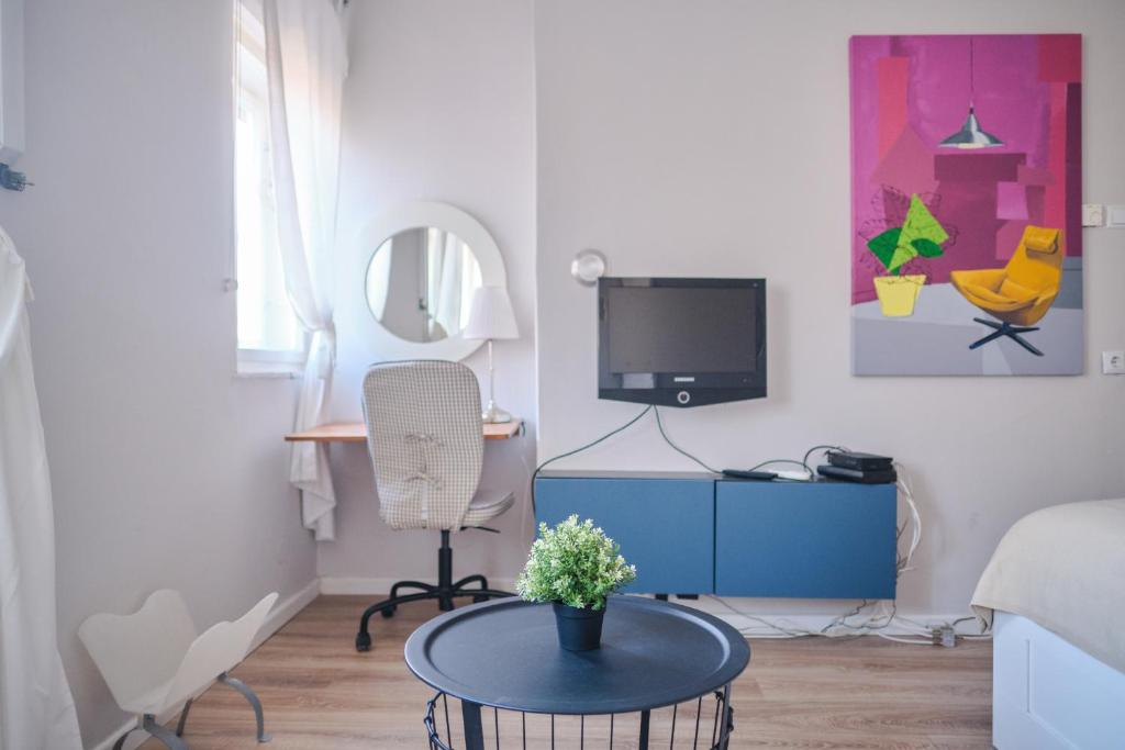 A television and/or entertainment center at BOOKit apartment