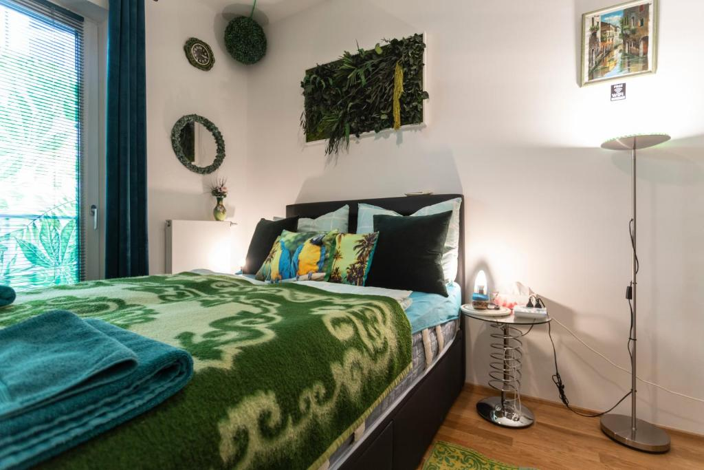 A bed or beds in a room at Small peaceful room to relax in emerald colours