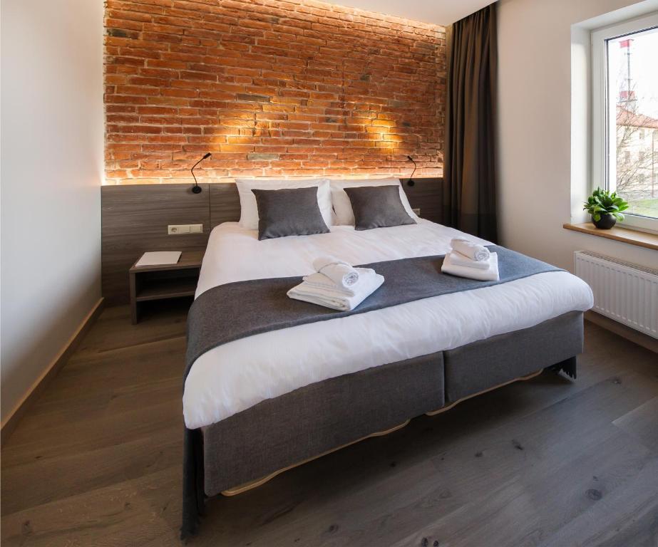 Lova arba lovos apgyvendinimo įstaigoje Dangė Hotel