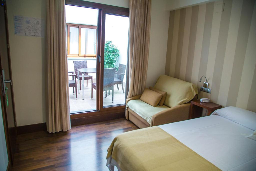 A bed or beds in a room at Cordoba Carpe Diem