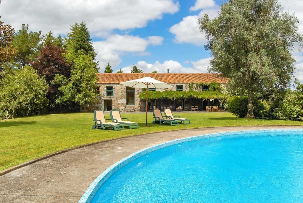 The swimming pool at or near Alentem Villa Sleeps 8 WiFi