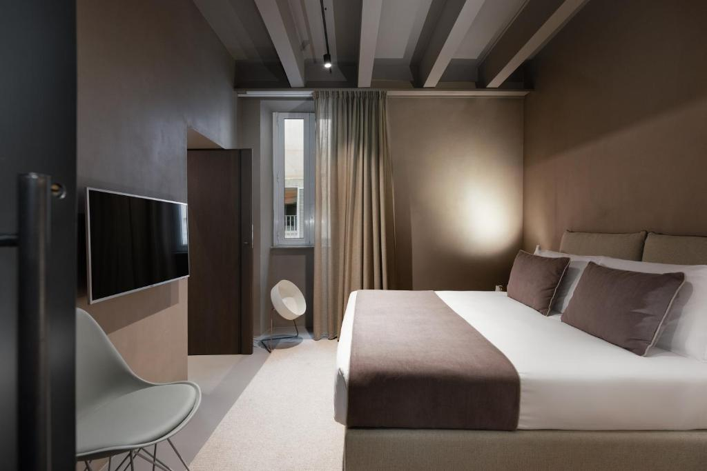 A bed or beds in a room at The Suite Babuino 119