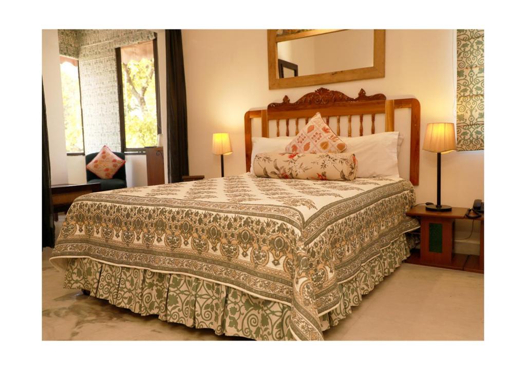 Кровать или кровати в номере Kailrugji - A City Center Hotel