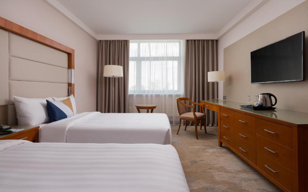 Кровать или кровати в номере Отель Кортъярд Марриотт Москва Центр