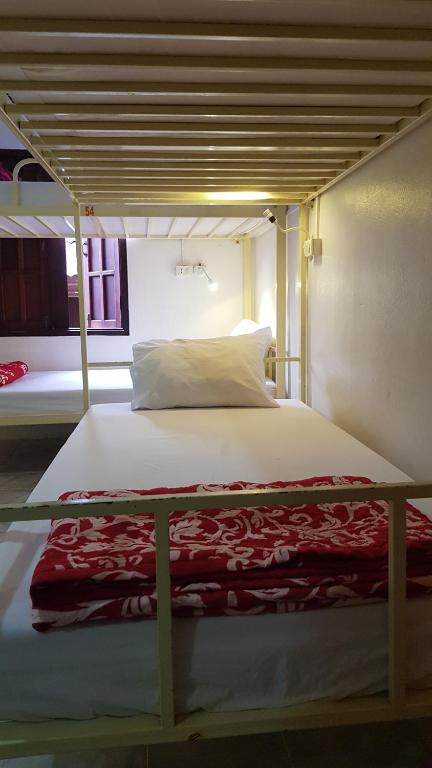 A bed or beds in a room at Vongprachan Bed&Breakfast Hostel