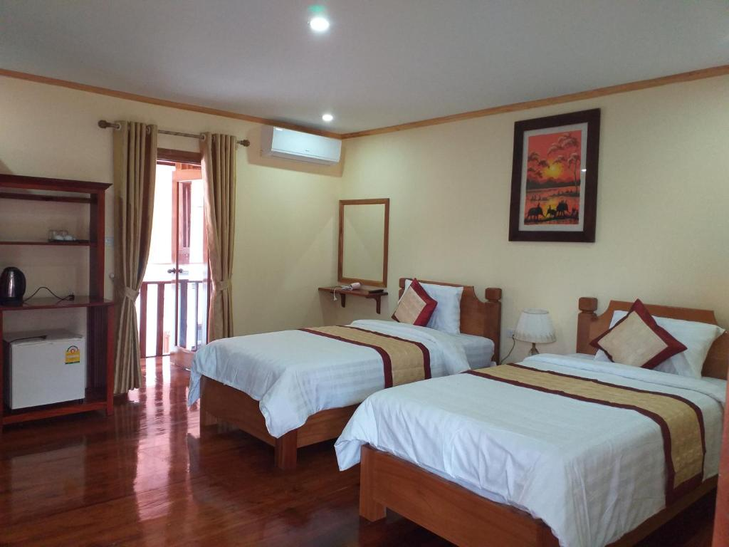 A bed or beds in a room at Xayana Home