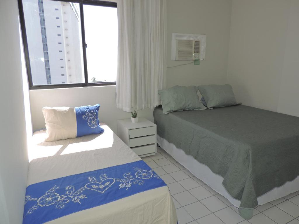 A bed or beds in a room at Flat Pina/Boa Viagem
