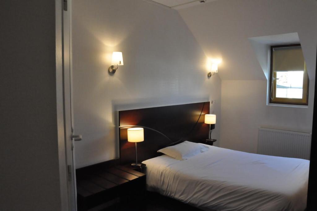 Un ou plusieurs lits dans un hébergement de l'établissement Lorient Hôtel - Roazhon Park