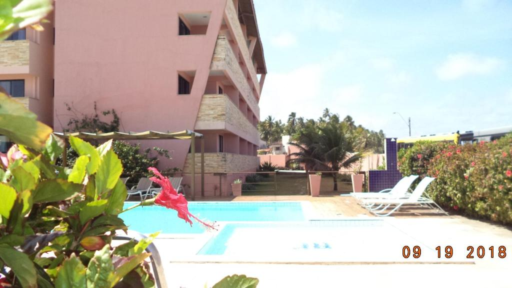 The swimming pool at or near Atlântico Hotel
