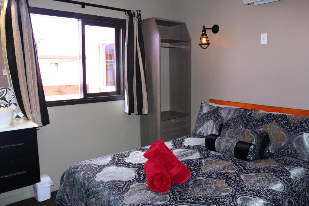 A bed or beds in a room at Duke Hostel