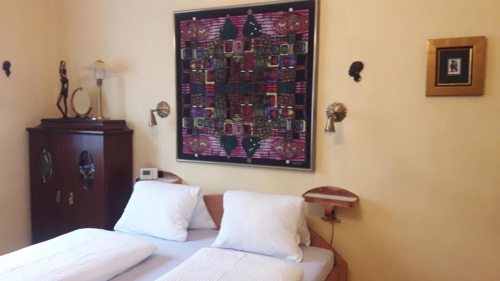 Ein Bett oder Betten in einem Zimmer der Unterkunft City Apartments am Passauerplatz