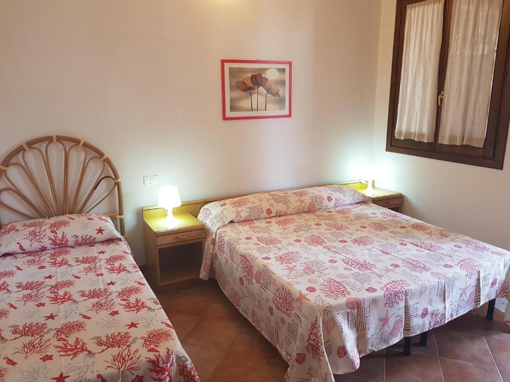 Letto o letti in una camera di Villaggio Appartamenti Egad