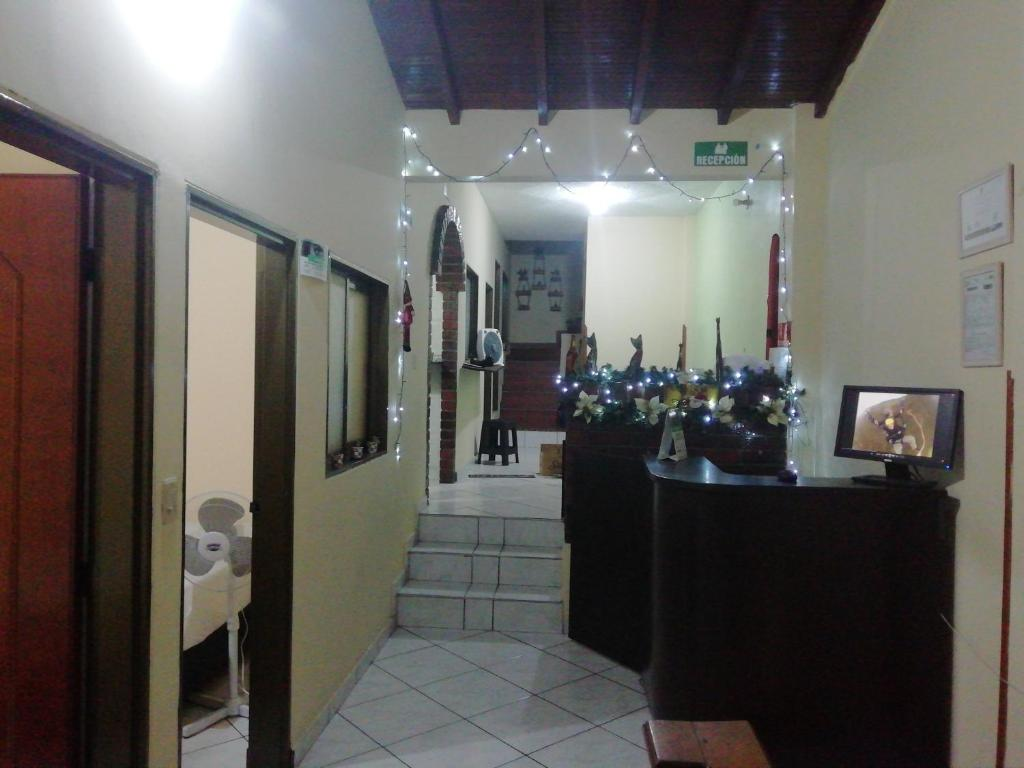 The lobby or reception area at Icaro Hostel
