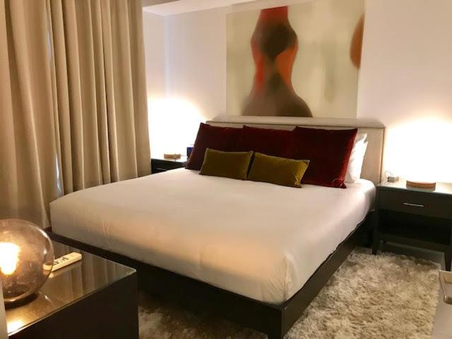 A bed or beds in a room at Gold Coast Aruba - Aurum Collection