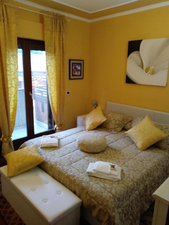 Postel nebo postele na pokoji v ubytování Rosso Frida