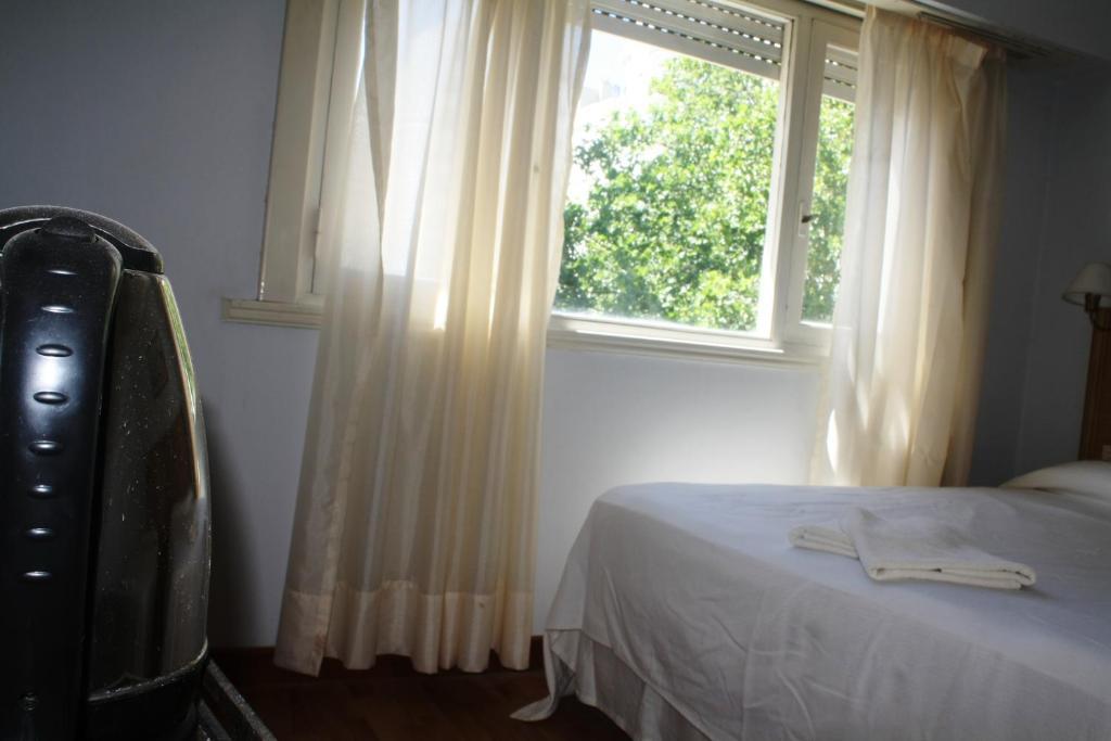 Una cama o camas en una habitación de Hotel Cadoro