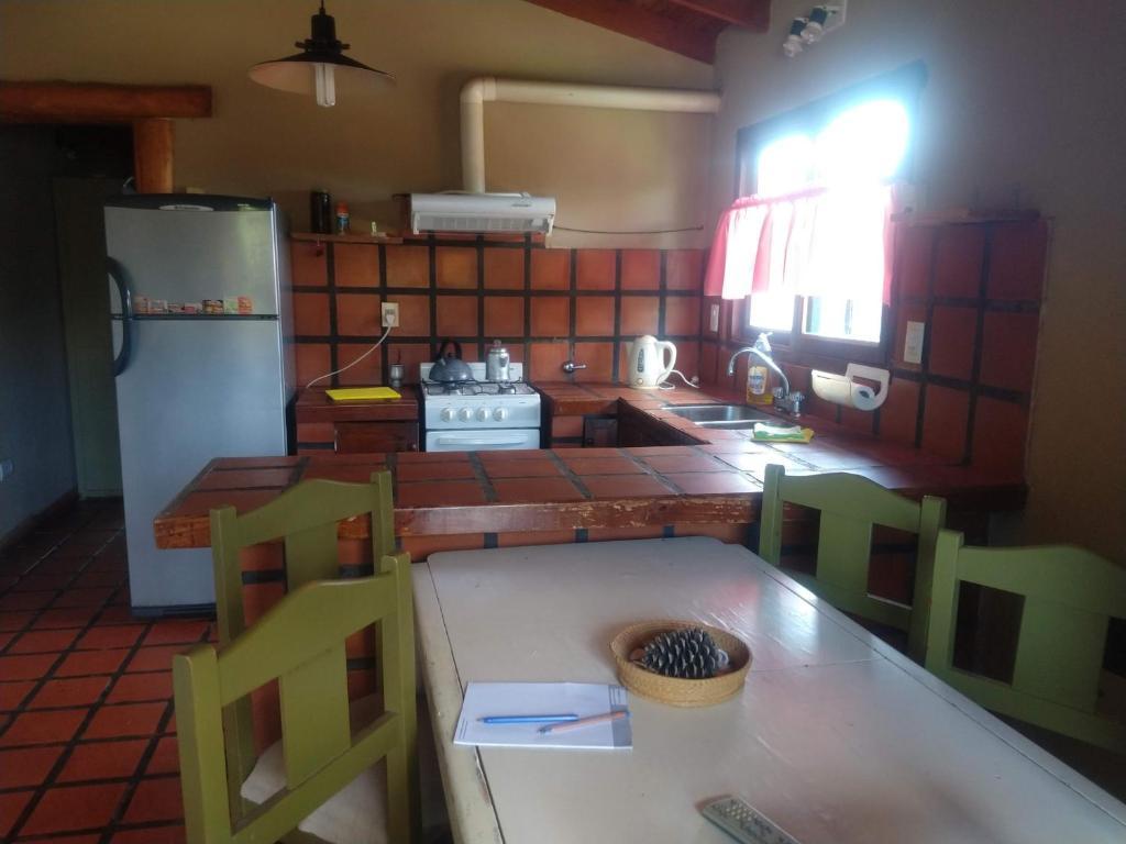 "Una cocina o kitchenette en ""Zahra Depto"""