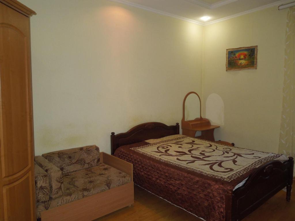 Кровать или кровати в номере улица Еськова архитектора8 ,КВ8