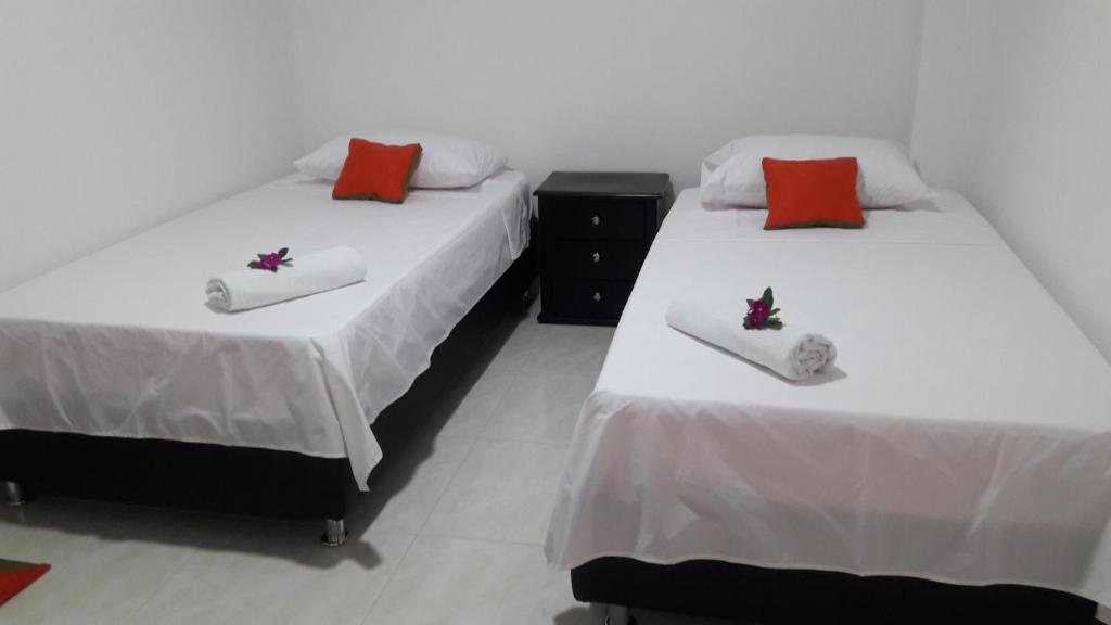 A bed or beds in a room at Puerto Caribe Hostal