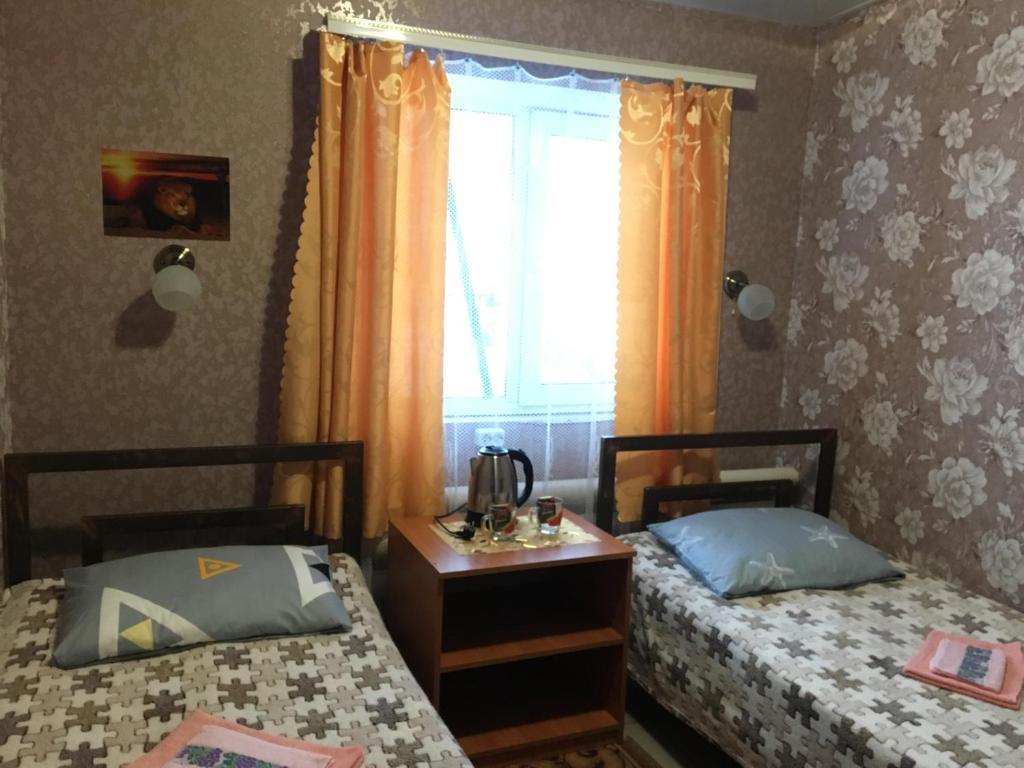 Кровать или кровати в номере Мини - Отель ASSORTI