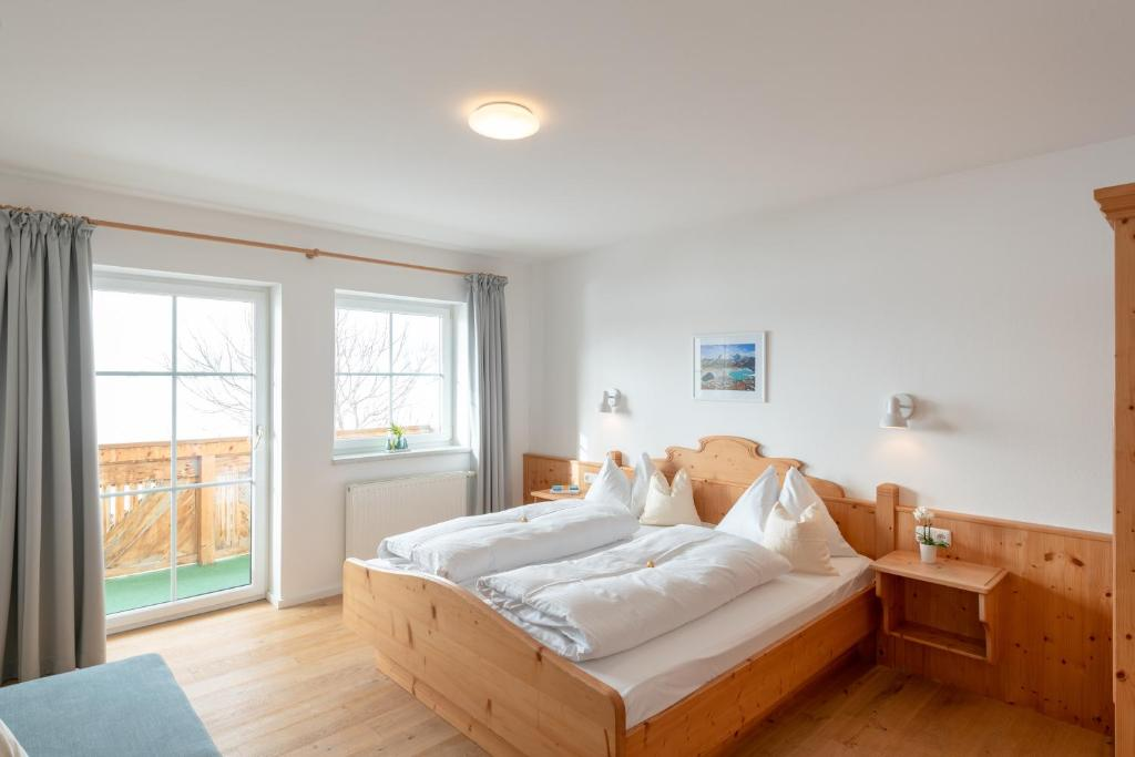 A bed or beds in a room at Apartments Stadler