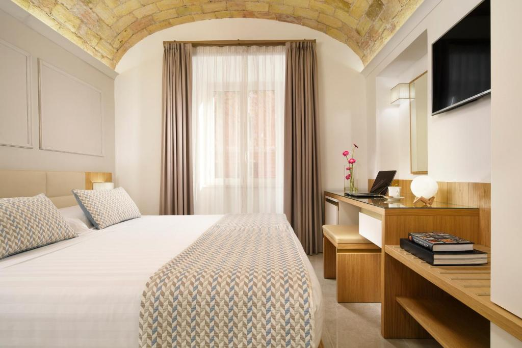 A bed or beds in a room at Magica Luna Boutique Hotel - Roma