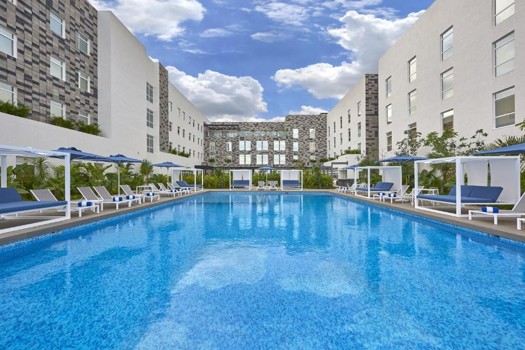 The swimming pool at or near City Express Plus Cancun Aeropuerto Riviera