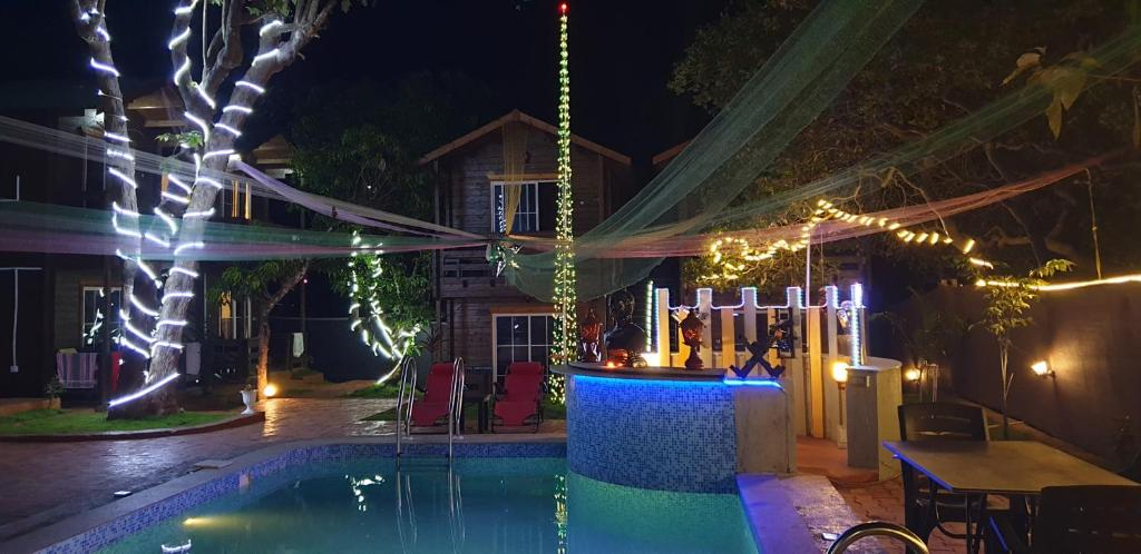 The swimming pool at or near Samaayaa Cottages & Cafe