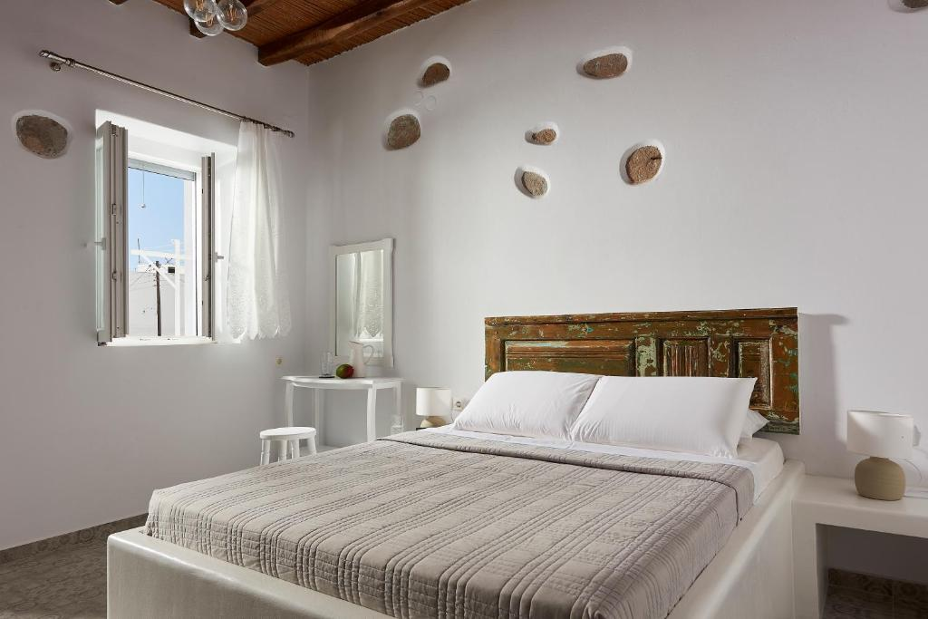A bed or beds in a room at LUXMIL