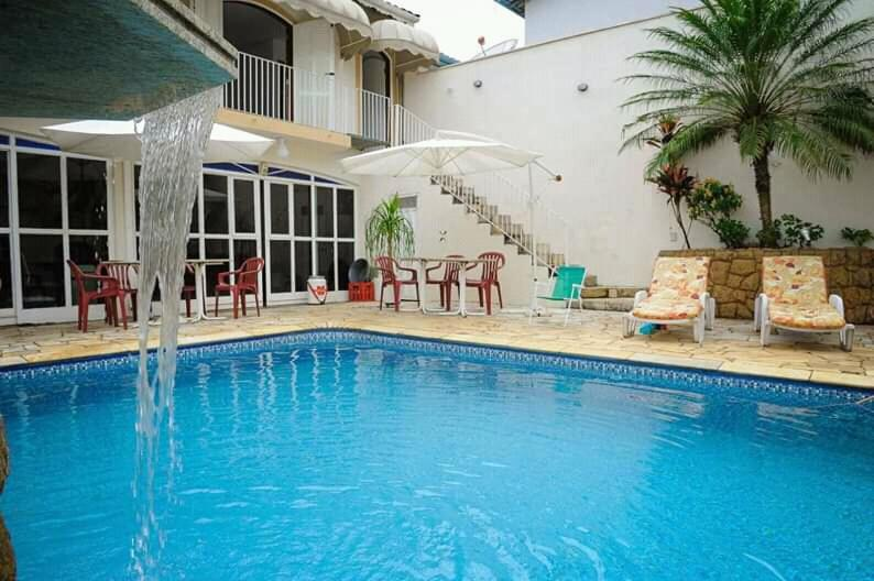 The swimming pool at or near Residencial Aconchego