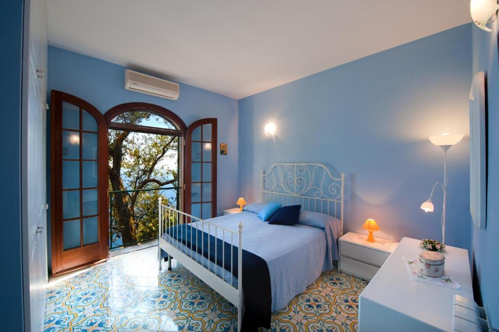 A bed or beds in a room at Casa Marea