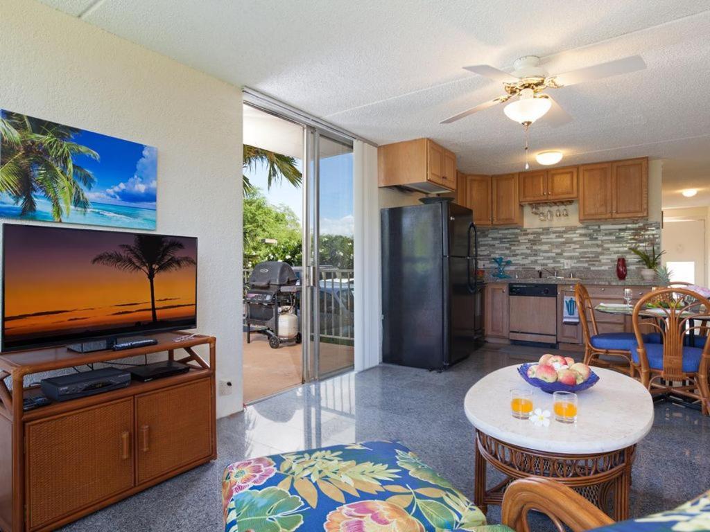 A kitchen or kitchenette at Puako Beach Condo 109
