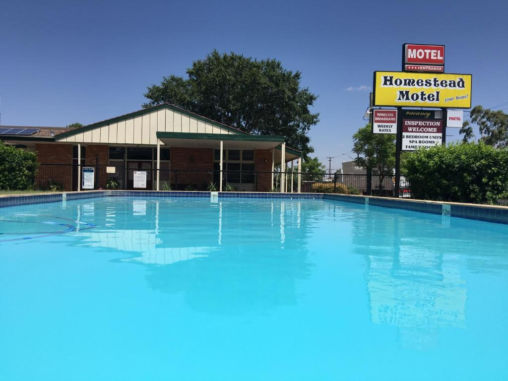 The swimming pool at or near Homestead Motel