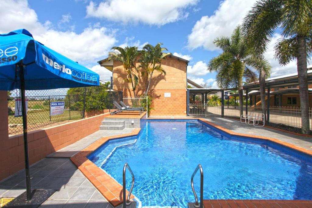 The swimming pool at or near Windmill Motel & Events Centre