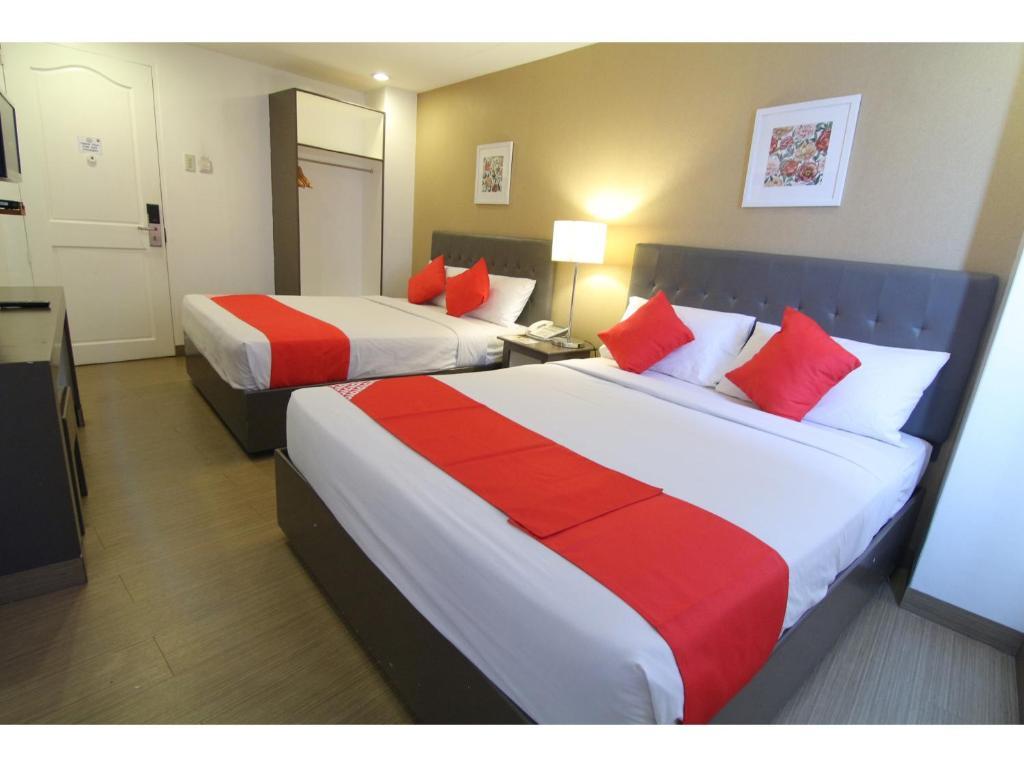 Ein Bett oder Betten in einem Zimmer der Unterkunft OYO 106 24H City Hotel