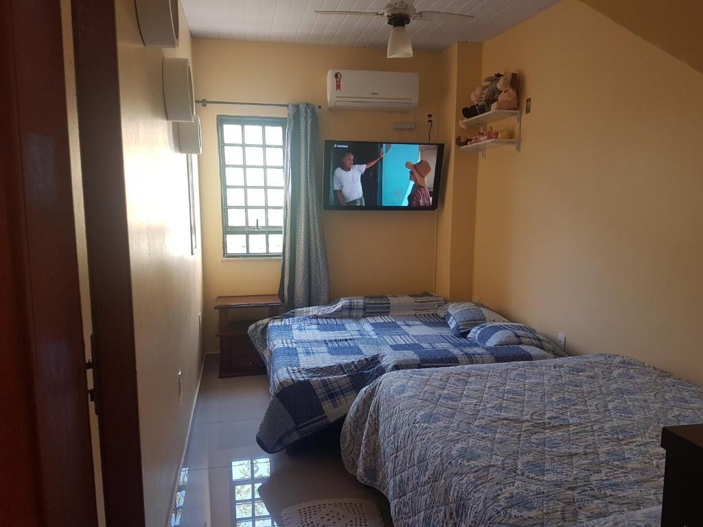 A bed or beds in a room at Quarto Aconchegante em São Cristóvão