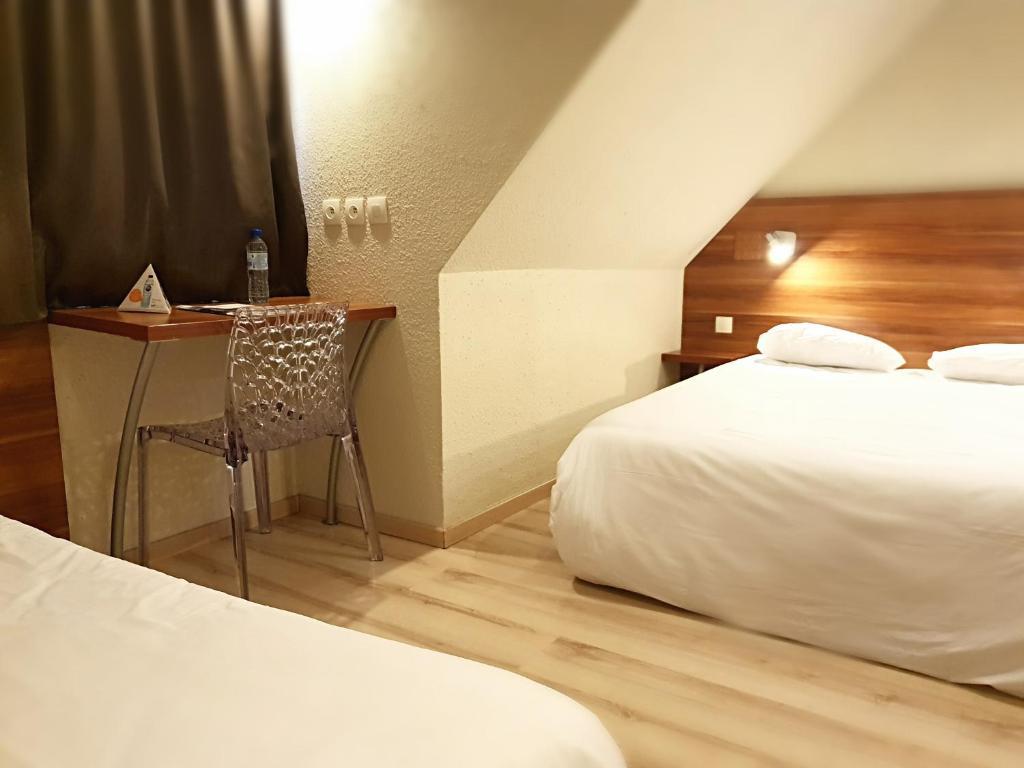 Ein Bett oder Betten in einem Zimmer der Unterkunft Brit Hotel Primo Colmar Centre