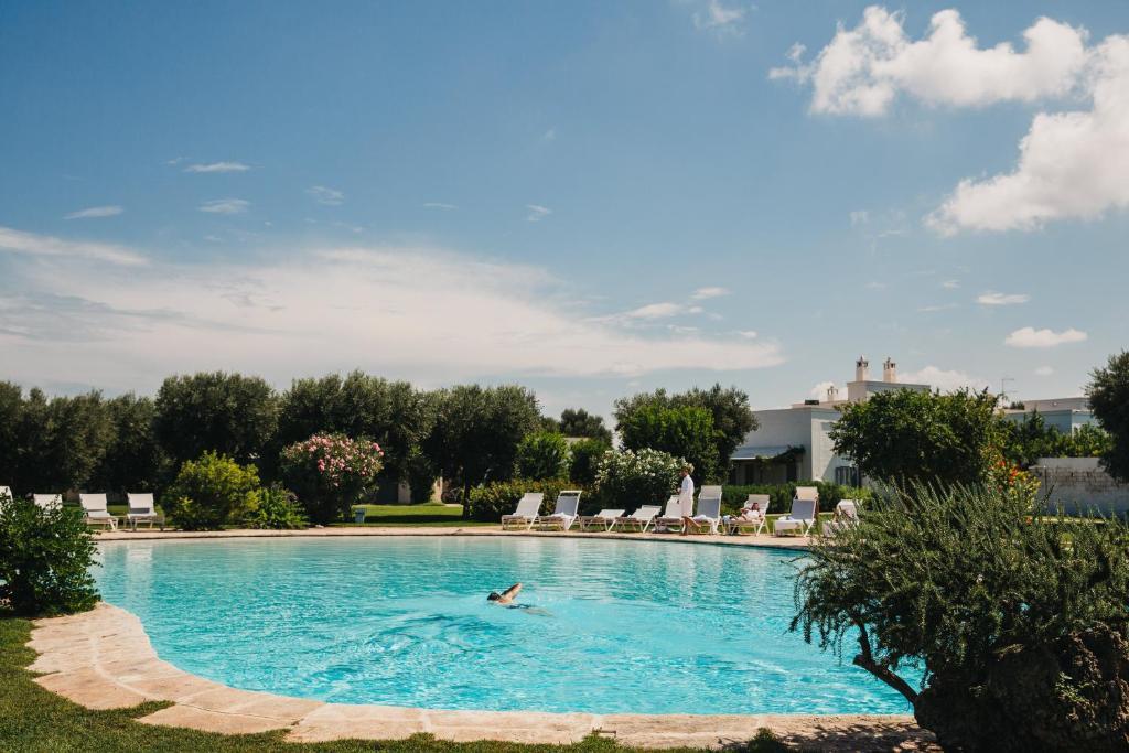 The swimming pool at or near Masseria Don Luigi-Luxury Farmhouse
