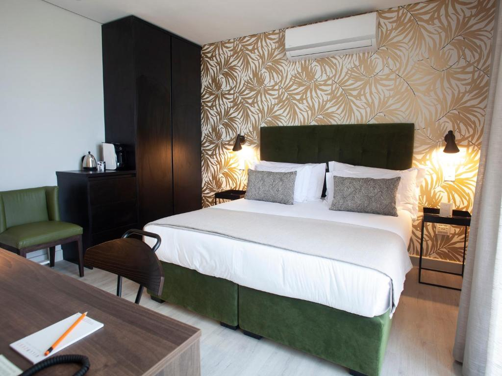 A bed or beds in a room at Villa Zest Boutique Hotel