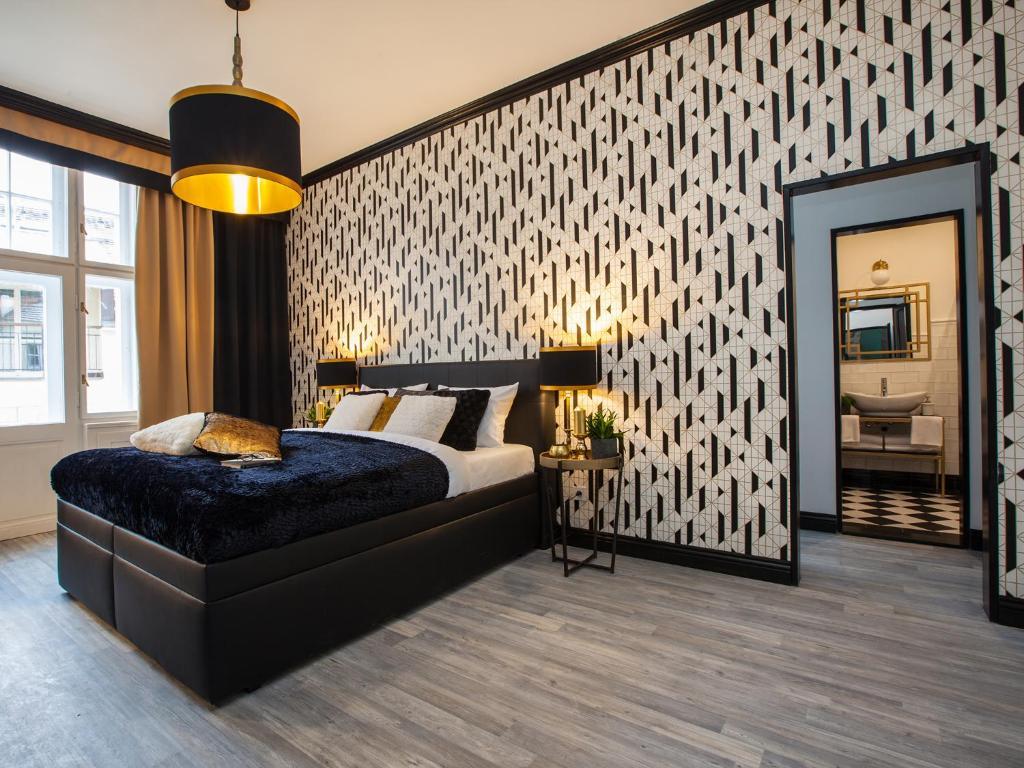 Ein Bett oder Betten in einem Zimmer der Unterkunft Golden Prague Rooms
