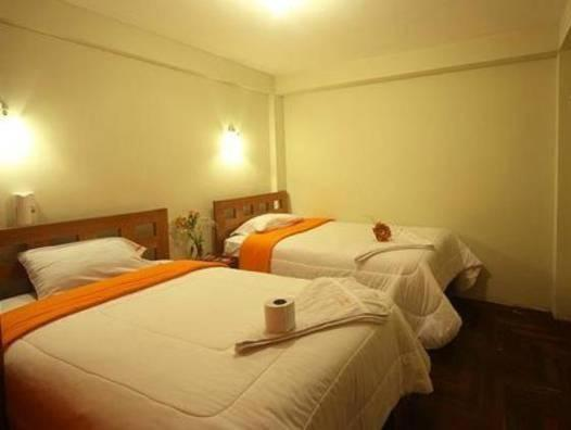 A bed or beds in a room at Casa 7 Cusco