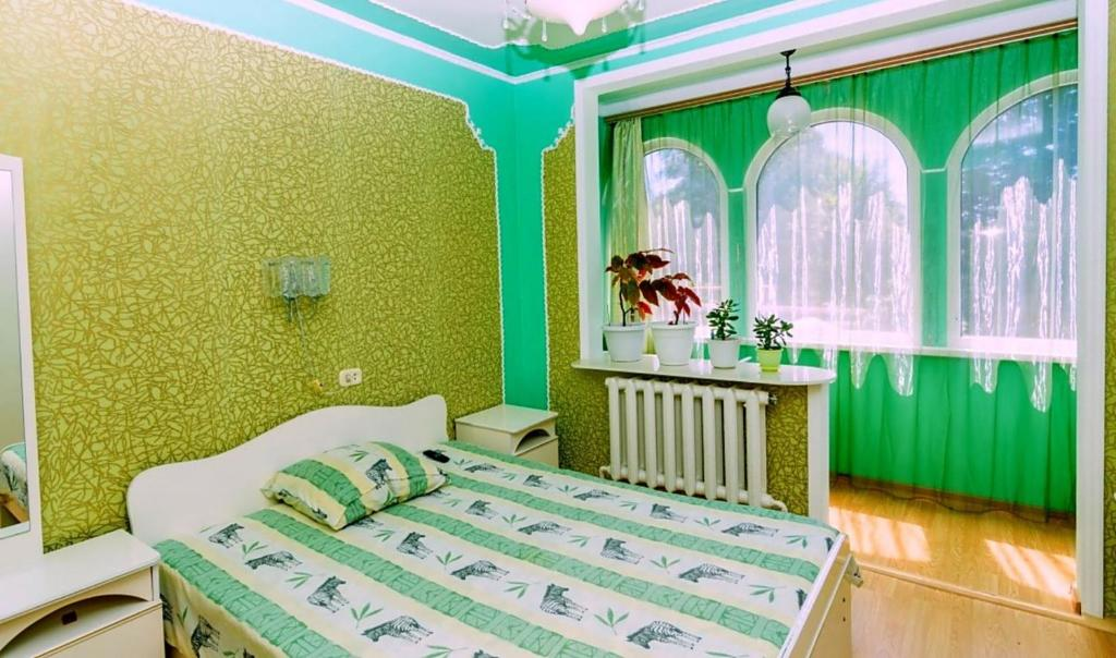 A bed or beds in a room at Lazurny Bereg Guest House