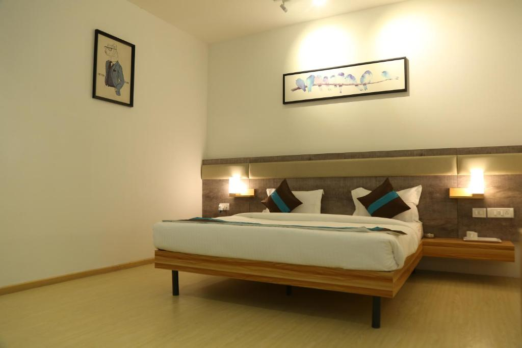A bed or beds in a room at Hotel Abinand Grand