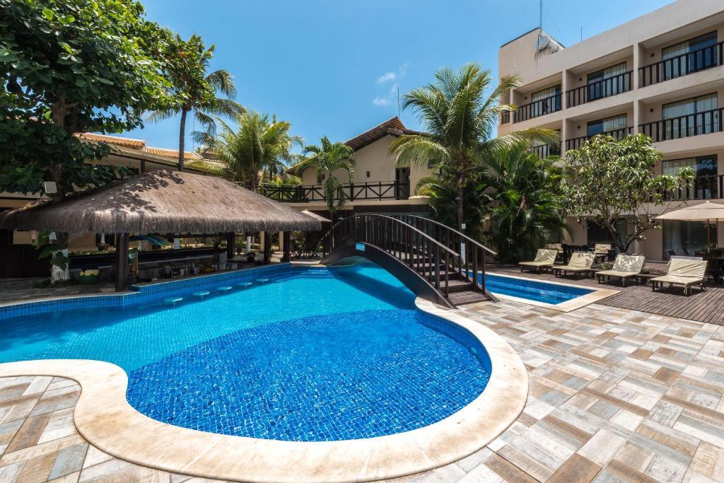 The swimming pool at or near Pousada Recanto do Lobo
