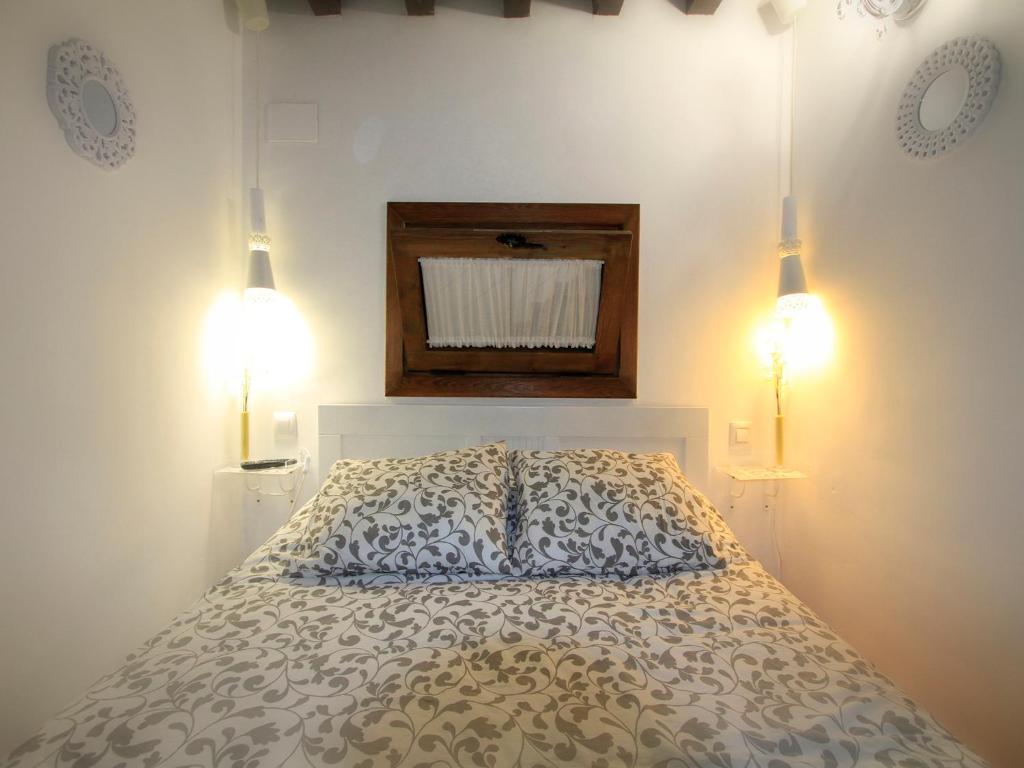 Letto o letti in una camera di Apartamentos Toledo Suite